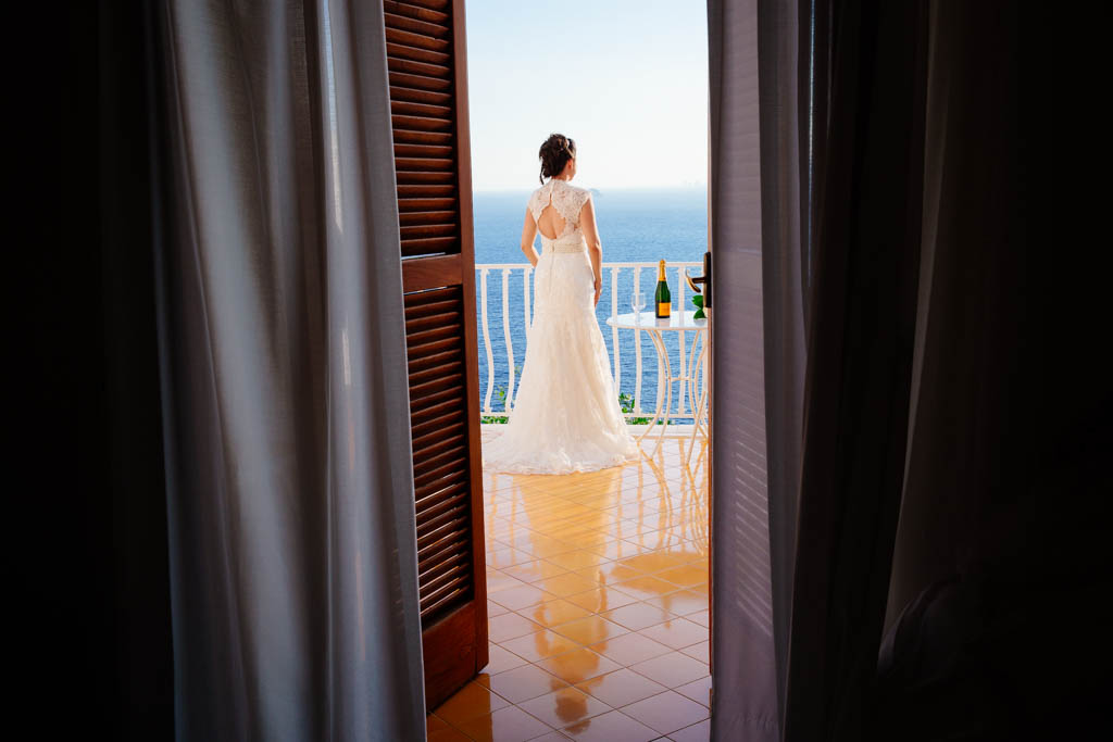 a bride enjoying the view from hotel tramonto d'oro in praiano